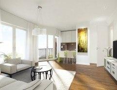Heller Wohnraum mit Parkett und Blick auf die Küchentheke