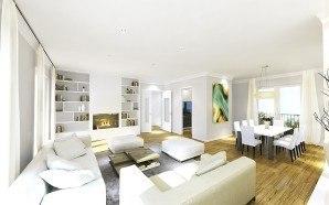 Heller Wohnraum mit Parkett und eierschalfarbenen Sofas und Essecke